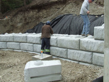 Our employees building retaining wall